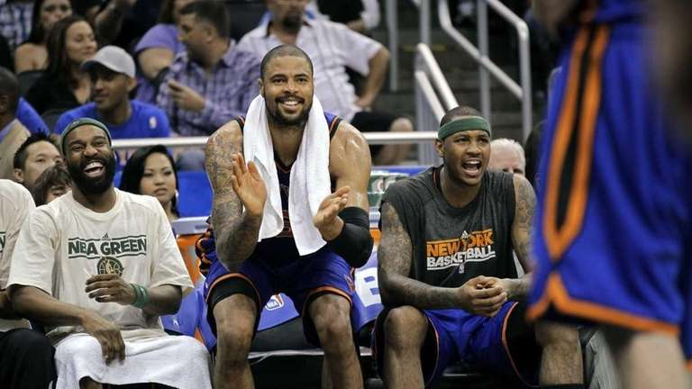 Knicks center Tyson Chandler cheers on his teammates