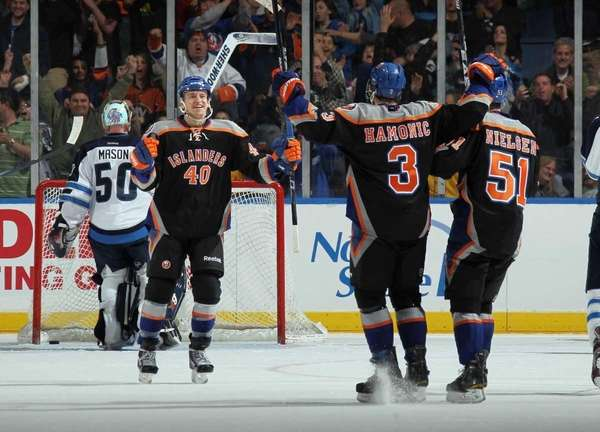Michael Grabner celebrates his game winning goal at