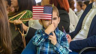 Jacob Peralta holds the American flag while accompanying