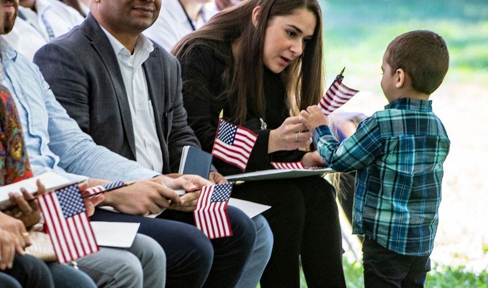 Copaigue resident Carolina Peralta shares the American flag