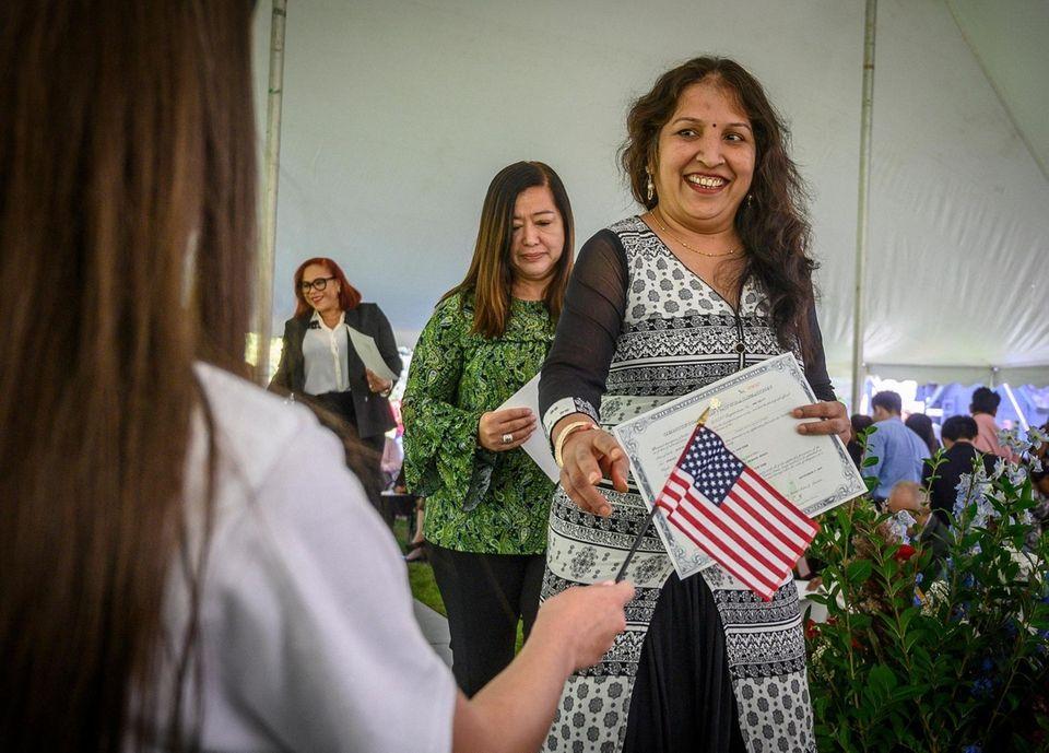 Massapequa resident, immigrant Sarika Mehta receiving her American