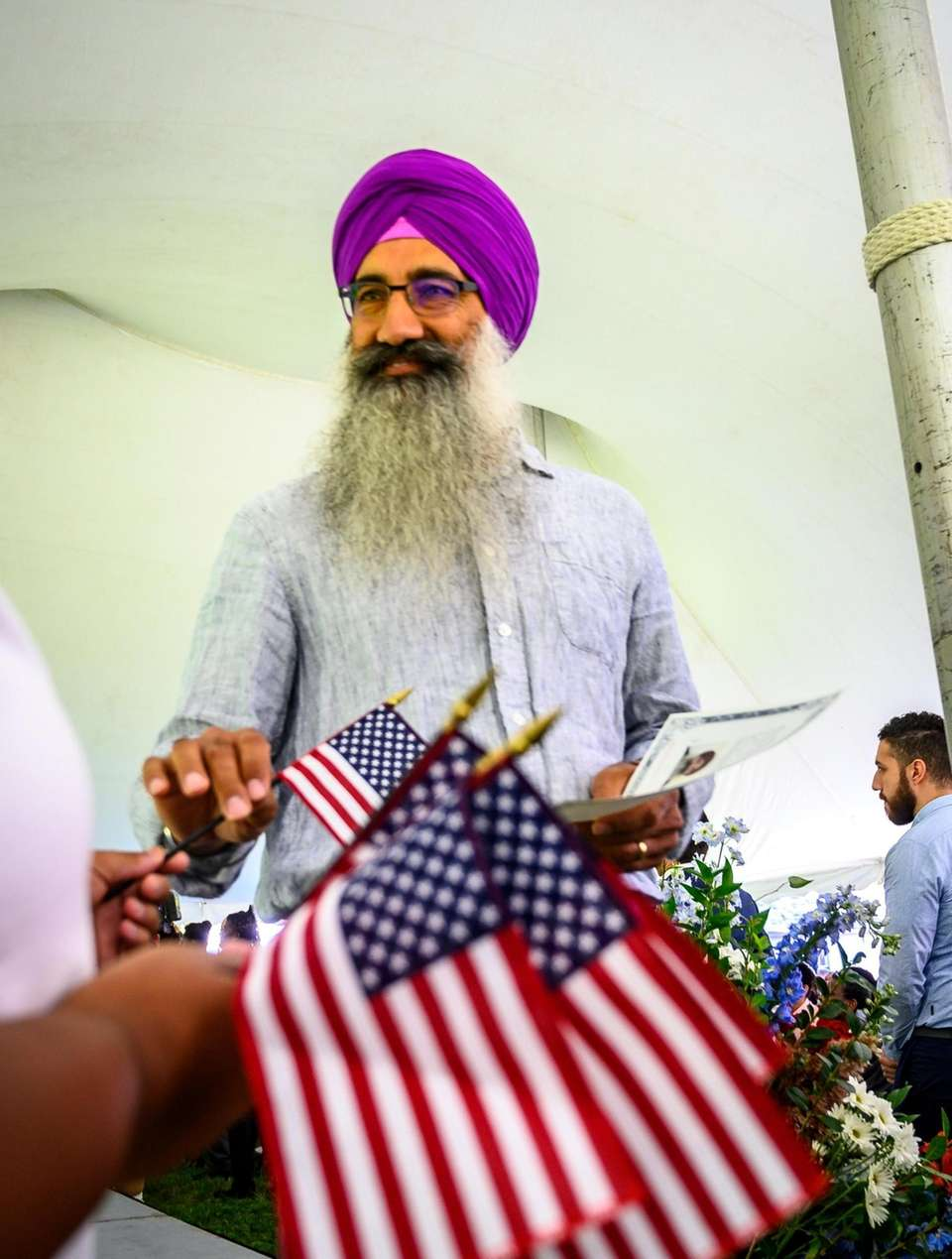 Seacliff resident, immigrant Balbinder Bhogal receiving his American