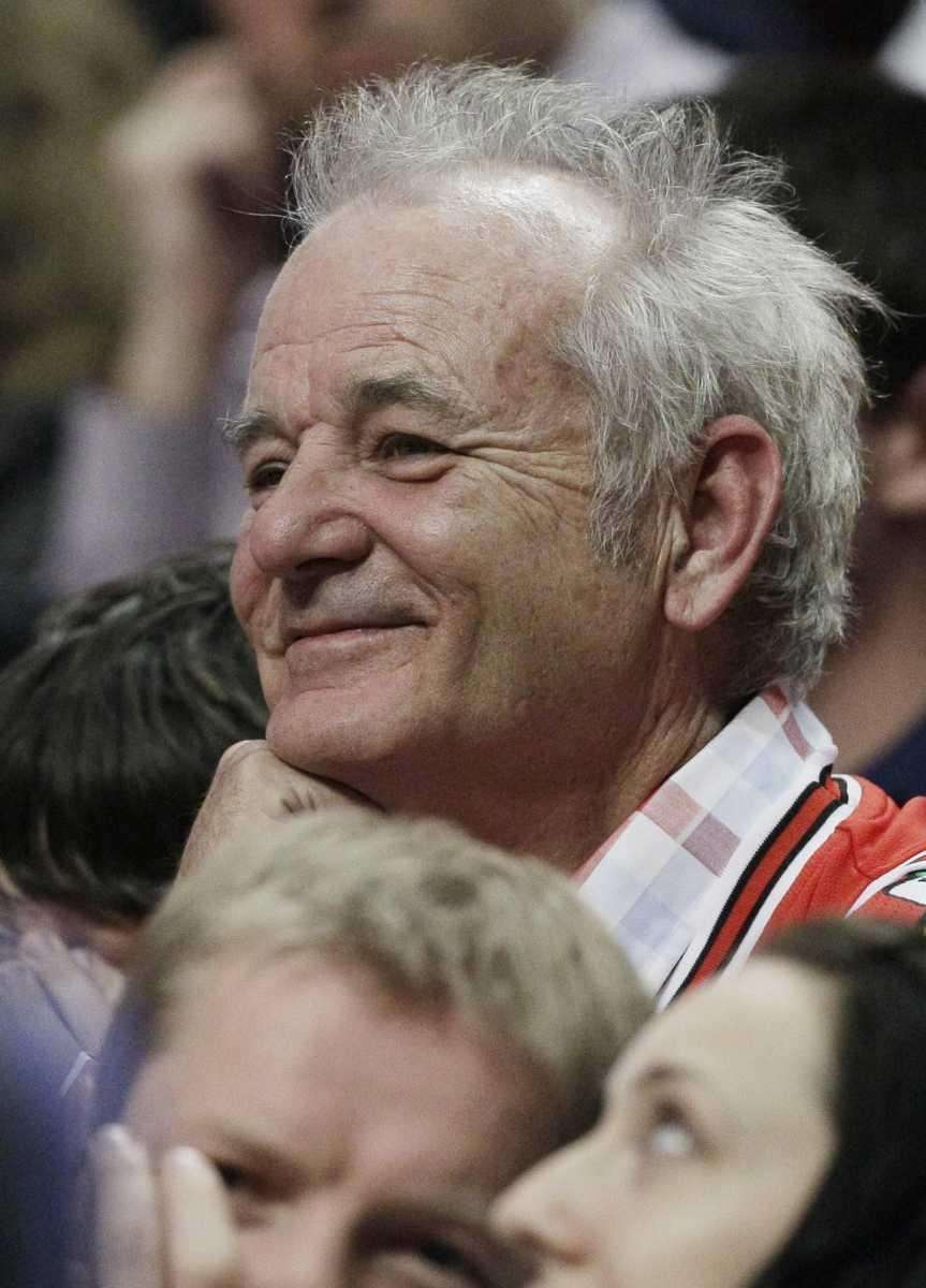 Bill Murray watches an NBA basketball game between