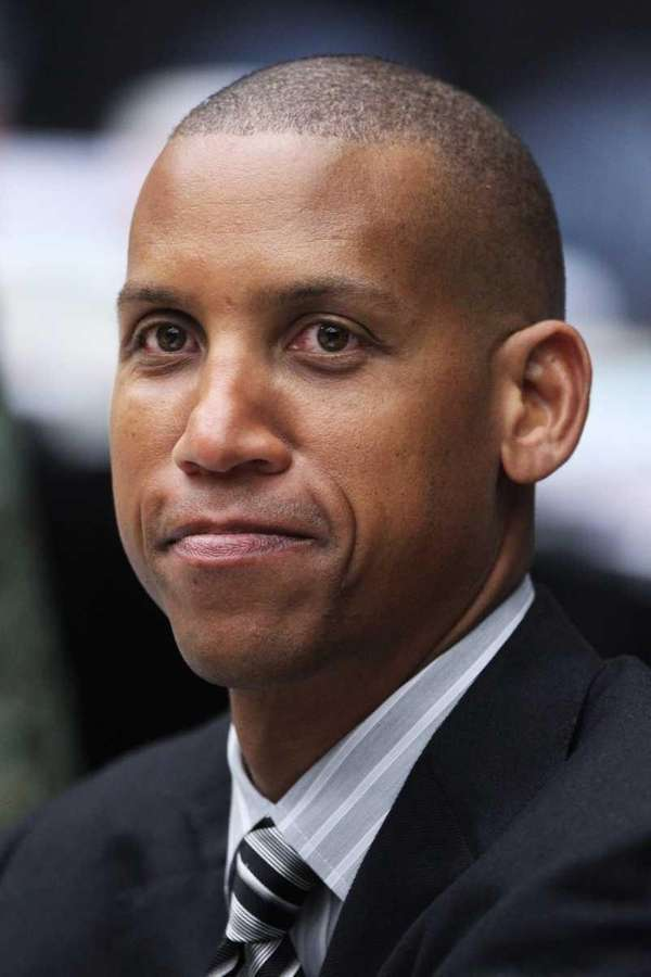 Former NBA player Reggie Miller attends the game