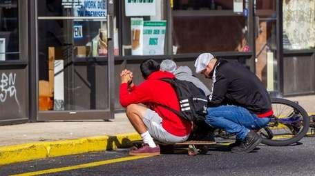 Friends gather at the scene on Sept. 17,