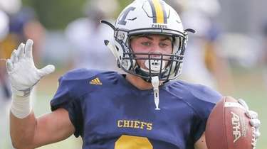 Massapequa's Alex Rende pulls in a pass and