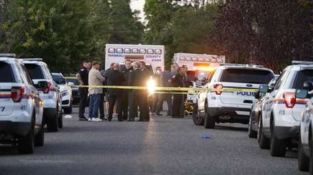 Nassau police investigate the scene of reported shots