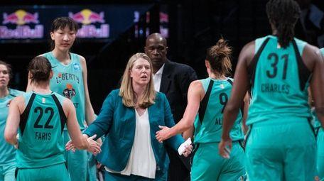 Liberty head coach Katie Smith talks to team