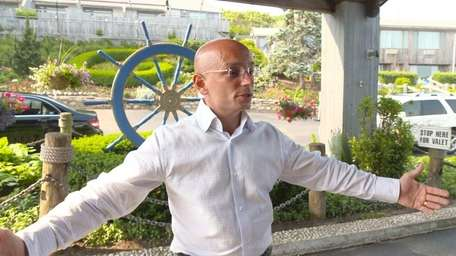 Anthony Melchiorri stands at the entrance of Gurney's