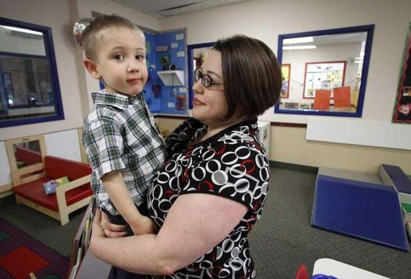 Kelly Andrus holds her son Bradley in his
