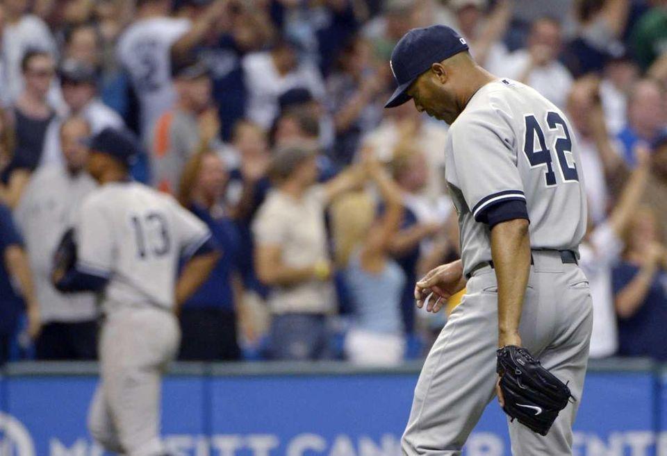 Yankees closer Mariano Rivera walks off the field