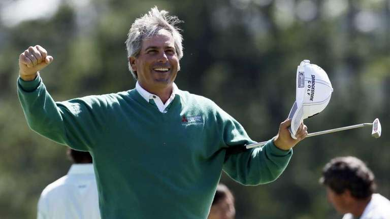 Fred Couples celebrates after finishing the second round