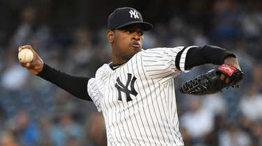 Yankees starting pitcher Luis Severino delivers against the