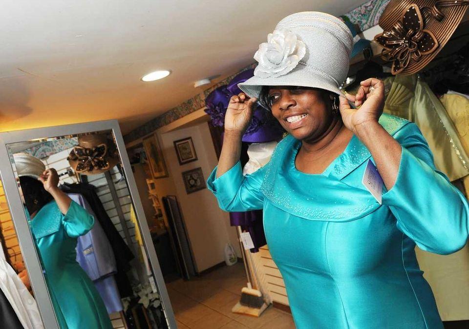 Barbara Douglas-Robinson of Massapequa tries on Easter bonnets