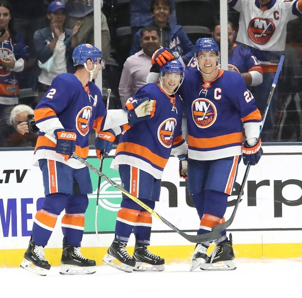 Islanders Nick Leddy (2) and Anders Lee (27)