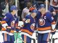 Islanders Nick Leddy (2) and Anders Lee (27)