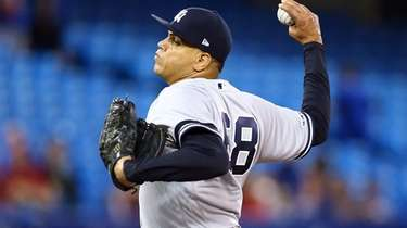 Dellin Betances #68 of the Yankees delivers a