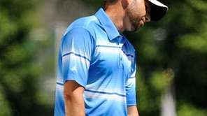 Sergio Garcia of Spain reacts to a muissed