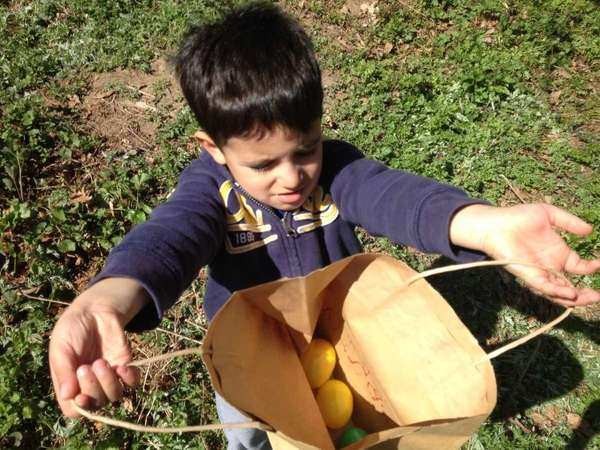 Gabriel Giannola, 4, shows off the eggs he