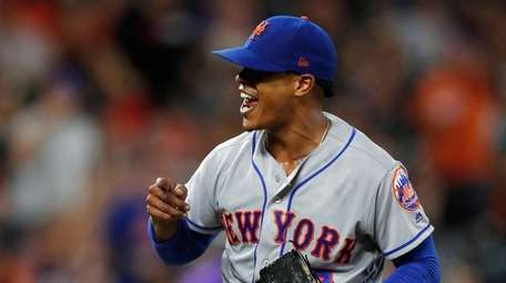 Mets starting pitcher Marcus Stroman reacts after catcher