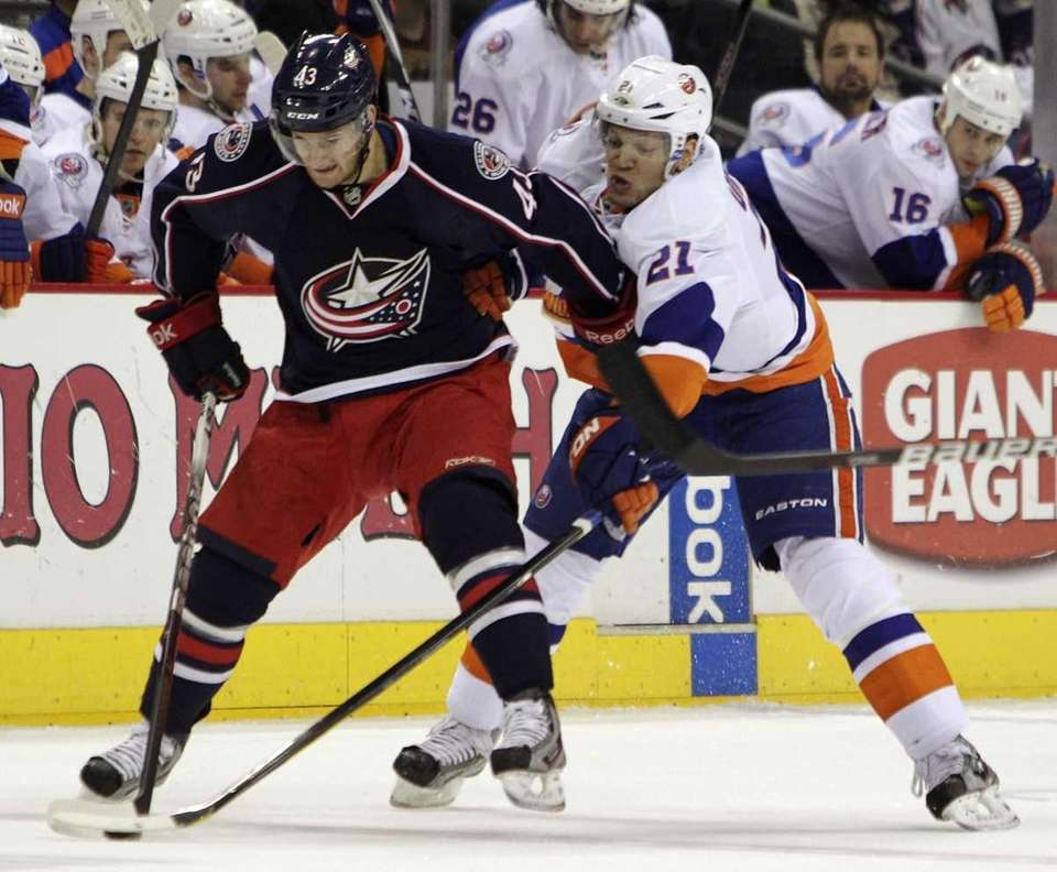 Columbus Blue Jackets' Darryl Boyce, left, keeps the
