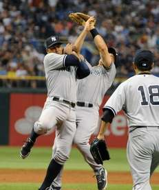 Infielders Alex Rodriguez #13 and Mark Teixeira #25