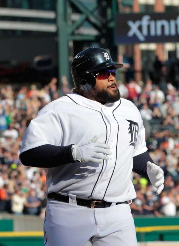 Prince Fielder #28 of the Detroit Tigers scores