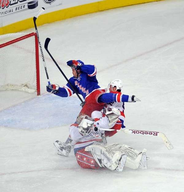 Brandon Prust of the Rangers collides with Mike