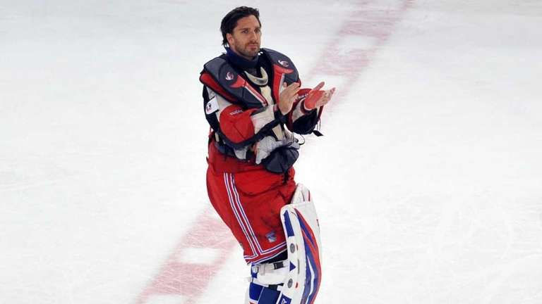 Henrik Lundqvist applauds the fans after the game.