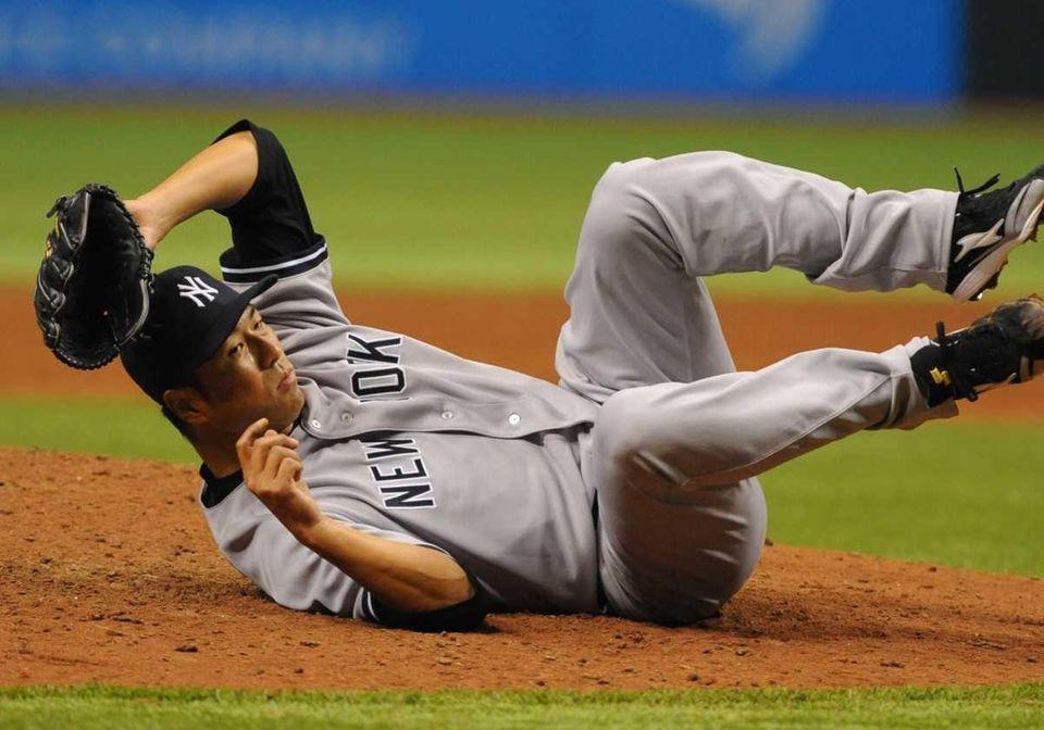 Pitcher Hiroki Kuroda #18 of the New York