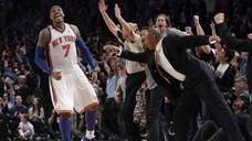 New York Knicks' Carmelo Anthony and fans react