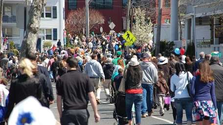 People head to Harborfront Park in the Village