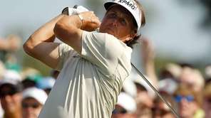 Phil Mickelson of the United States hits a