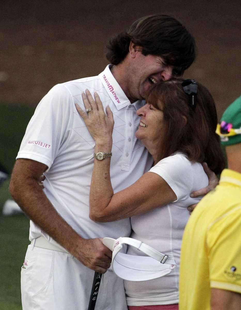 Bubba Watson hugs his mother Mollie after winning