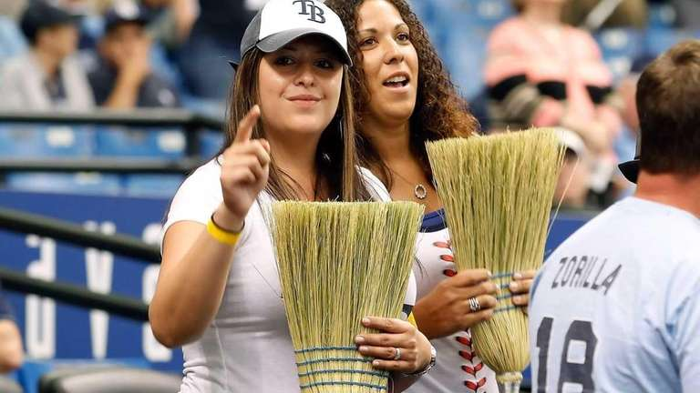 Fans of the Tampa Bay Rays brings brooms