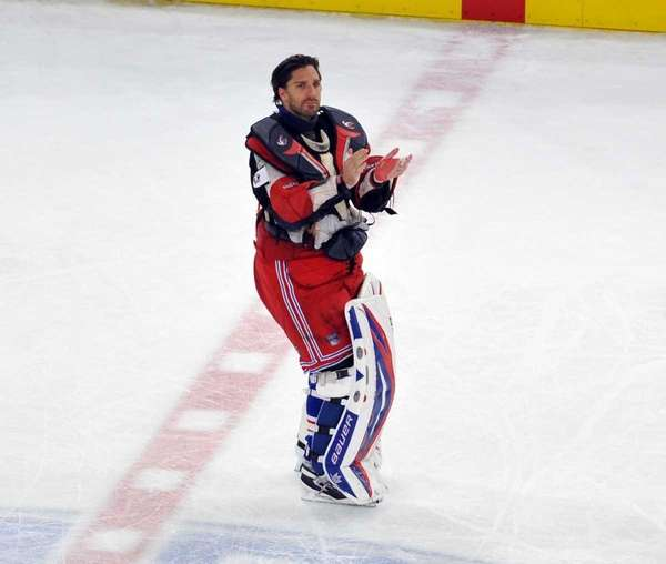 Henrik Lundqvist applauds the fans after the Rangers