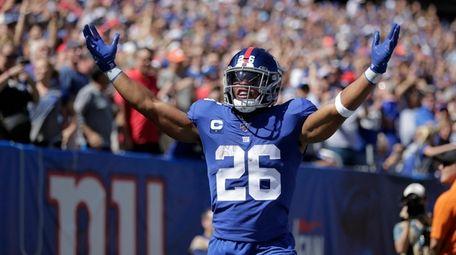New York Giants' Saquon Barkley celebrates his touchdown
