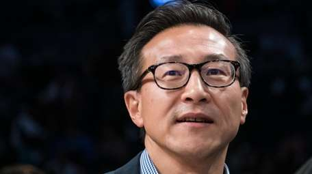 New York Liberty owner Joe Tsai looks on