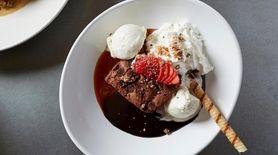 A warm brownie sundae with caramel ice cream
