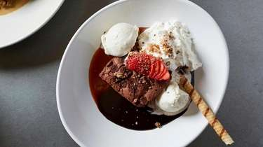 A warm brownie sundae with caramel ice cream