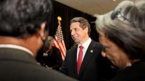 Gov. Andrew Cuomo mingles with the crowd after