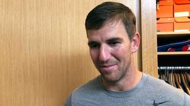 Giants quarterback Eli Manning speaks to the media
