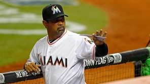Manager Ozzie Guillen of the Miami Marlins waves