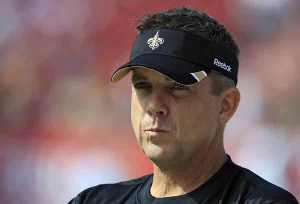 New Orleans Saints head coach Sean Payton watches