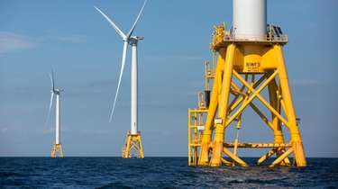 Three of Deepwater Wind's turbines stand in the