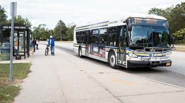 A Suffolk County Transit bus departs from the