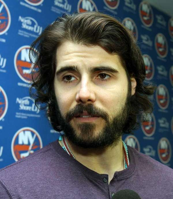 Rick DiPietro talks to reporters as Islanders clean