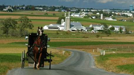 A horse and buggy travels along a Lancaster