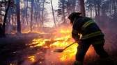 A firefighter battles a blaze in Manorville off