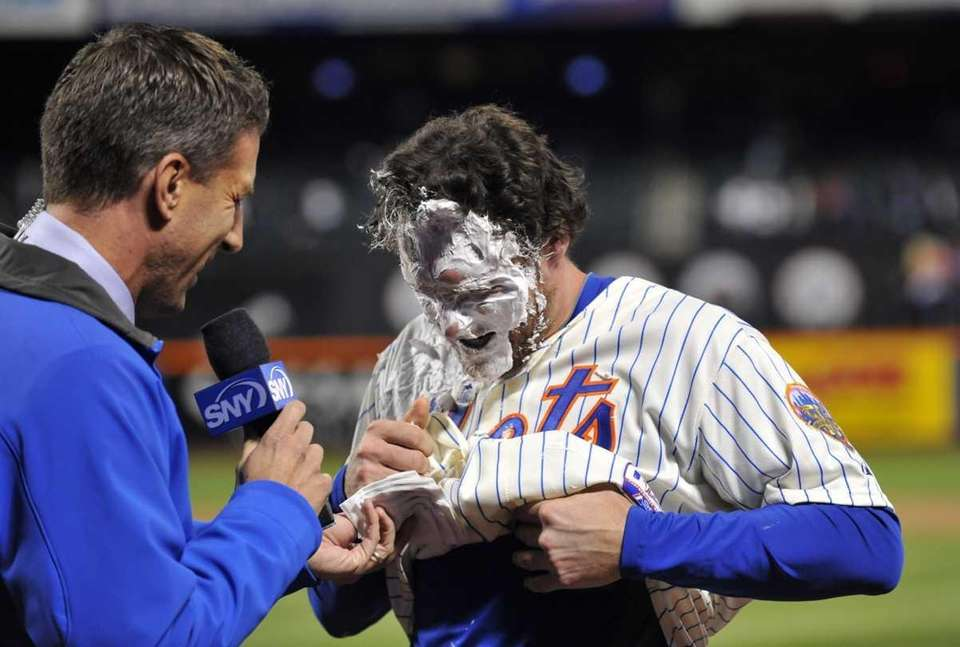 Daniel Murphy is covered in shaving cream after